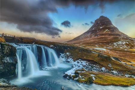 famous waterfall under the conical mountain Kirkjufellsfoss