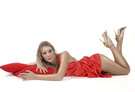 hot girl lying: Relaxing girl in red dress