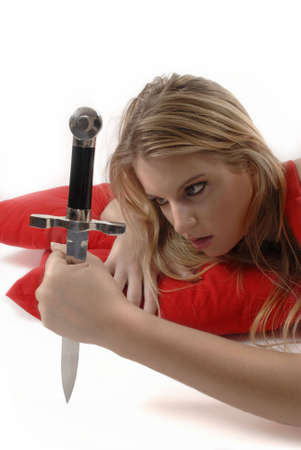 girl with knife: Girl flirting with knife Stock Photo