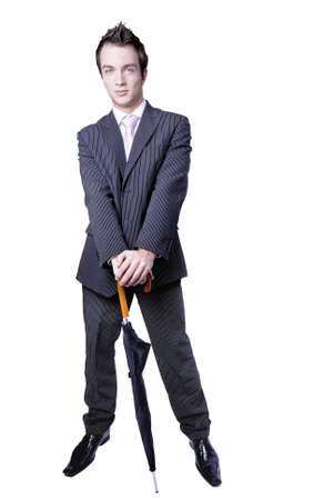 agrees: Businessman holds umbrella in his hands - isolated in studio with white background.