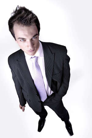 Businessman stands with one hand in pocket - studio shot. Stock Photo
