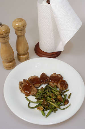 pepperbox: Picture of pork steak with french beans on plate.