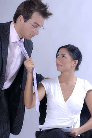 seducing: Young couple - woman is seducing her boss Stock Photo