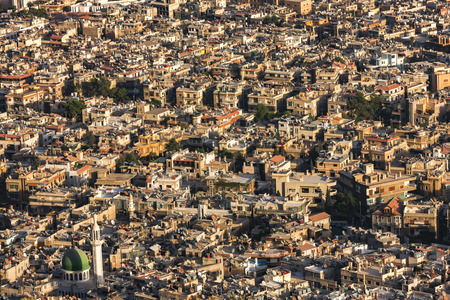 clashes: A view of Damascus before the civil war. Many buildings were destroyed because of the bombs and clashes in the war in Syria. Houses are yellow and warm. Photo was taken at sunlight in a summertime. Stock Photo