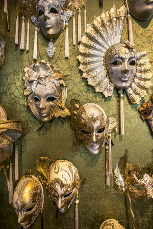 to seem: Masks that are used in Carnival of Venice have gold fancy works and tassels. They seem magnificent. Stock Photo