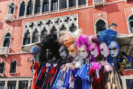 eye traveller: Masks that stand close each other symbolize emotions of people. Colorful masks seem very beautiful. Venice, Italy Stock Photo