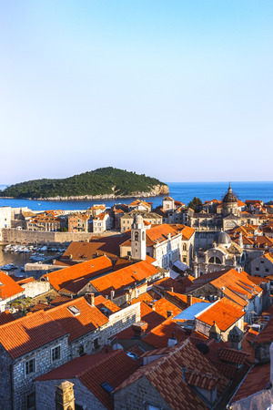 to seem: Cityscape of Dubrovnik at right angle. Blue sea, island and clear sky can seen in the photo at sunlight. Colors and sunlight seem very beautiful in Dubrovnik, Croatia.
