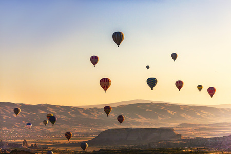 make known: Hot air balloons flying over volcanic mountains. Cappadocia is known as one of the best places to fly with air balloons. Curvy conical shapes of the rocks in valley make feel fantastic.