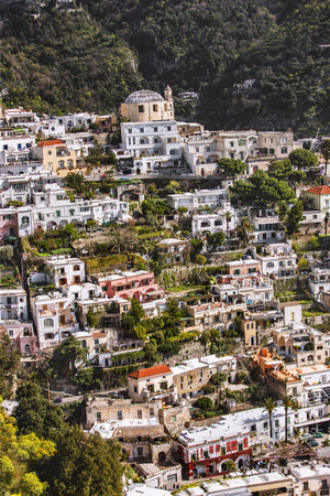 well maintained: A view of colorful houses and church. Landscape of a small town that is built on mountains within the forest. Church can seen on the hills. Town has old but well maintained buildings. Sorrento, Italy Stock Photo