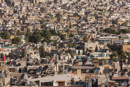 middle east conflict: A view of Damascus before the civil war. Many buildings were destroyed because of the bombs and clashes in the war in Syria. Houses are yellow and warm. Photo was taken at sunlight in a summertime. Stock Photo