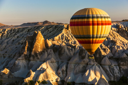 make known: Hot air balloon flying over hoodoos. Cappadocia is known as one of the best places to fly with air balloons. Conical shapes of fairy chimneys in valley make feel fantastic.