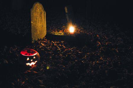 Halloween pumpkin on the cemetry