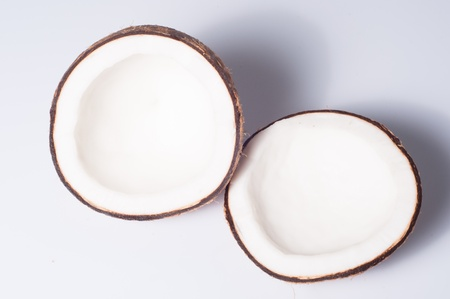 two halfs of coconut on white background Stock Photo