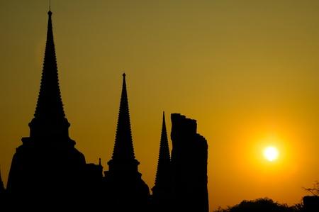 The stupa buddha and sunset at Ayutthaya Stock Photo
