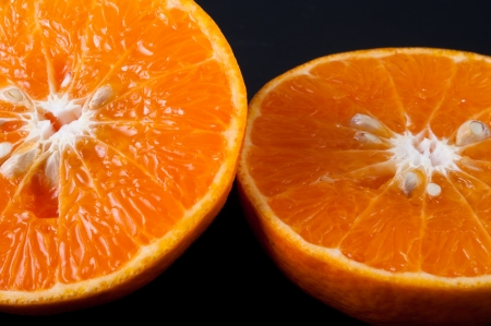 Fresh orange on a black background photo