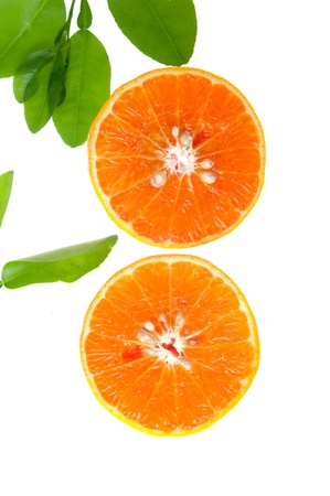 Fresh orange and leaves on a white background