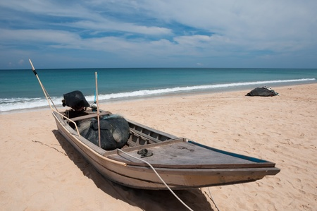 Fishing boat on a sea coast at the sunrise in morning Thailand Stock Photo