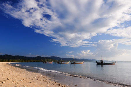 Fishing boats on the beach and blue sky