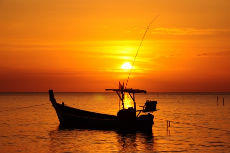 Fishing boats and the sea in the evening and sunset