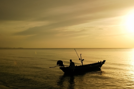 Fishing boats and the sea in the morning photo