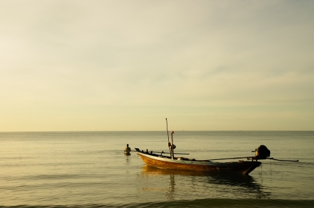 Fishing boats and the sea in the morning Stock Photo
