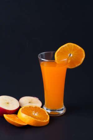 Orange juice and slices of orange  on white background