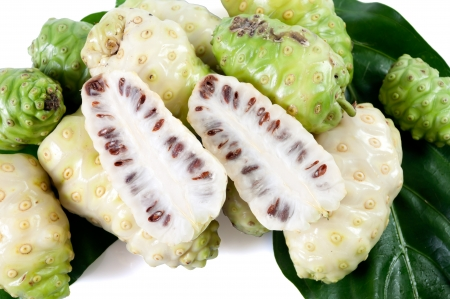 great morinda: Noni and fresh green leaves Stock Photo
