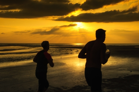 Exercise at the beach in the evening photo