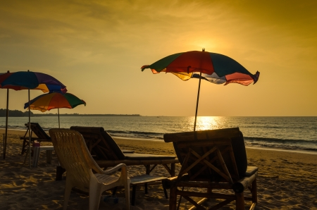 Beach chair and umbrella in the evening