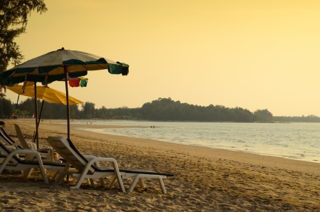 Beach chair and umbrella in the evening photo