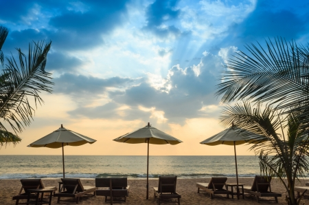 Beach chairs, umbrellas and evening  Stock Photo