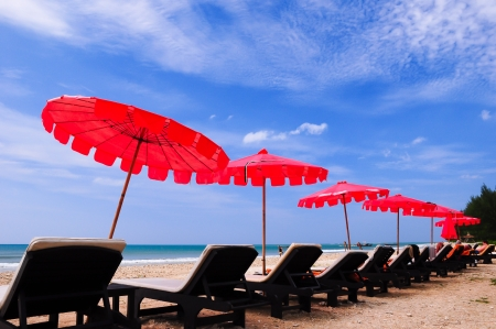 Red umbrella on the beach and blue sky