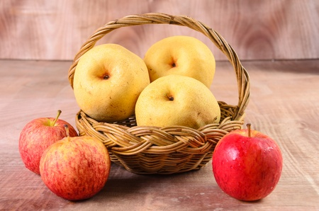 fresh apples on a wood background photo