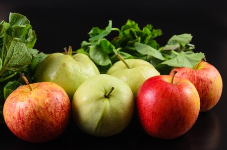 fresh fruit and vegetables on a black background Stock Photo
