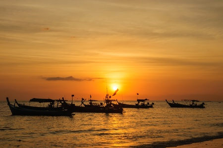 Fishing boats at the beach in the evening photo
