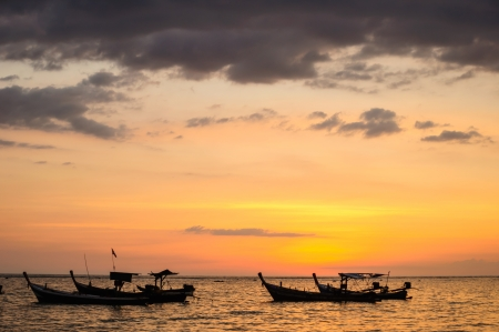 Fishing boats at the beach in the evening Stock Photo
