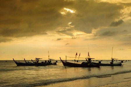 Fishing boat at the beach photo
