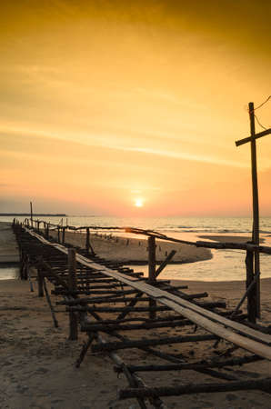 boardwalk on beach and sunset Stock Photo
