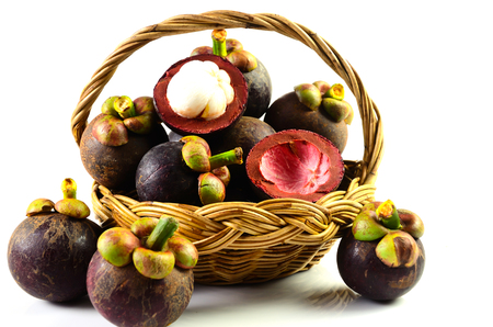 Mangosteen fruit basket on a white background