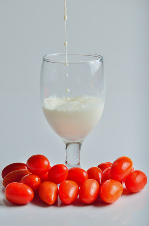 pouring a glass of milk on a white background photo