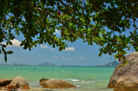 pristine corals: rocks sea and a beautiful blue sky