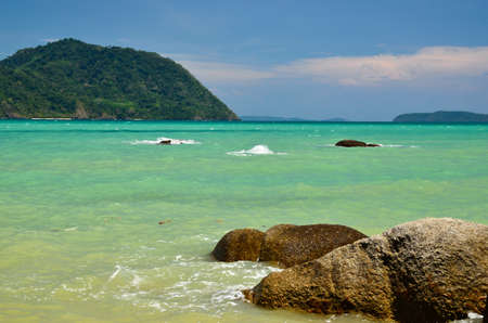 pristine coral reef: rocks sea and a beautiful blue sky