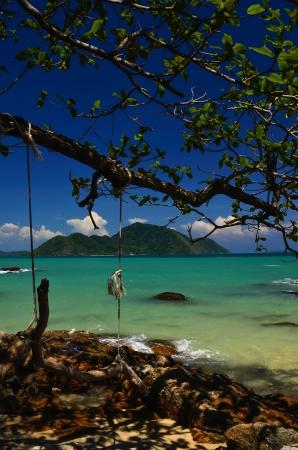 pristine corals: Sand rocks and beautiful blue sky