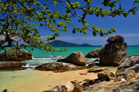 pristine coral reef: Sand rocks and beautiful blue sky