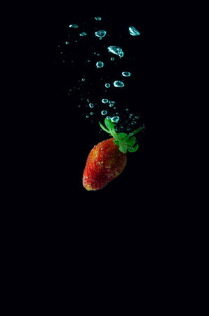 Tomato water splash on black background photo