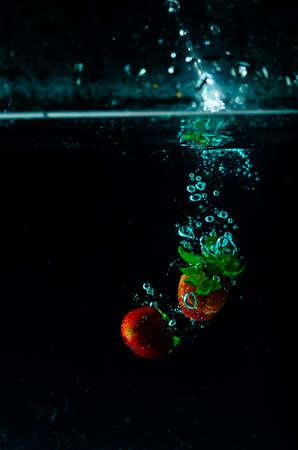strawberry water splash on black background