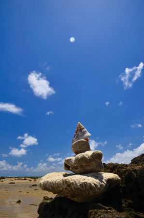 Beach rocks and the sky and clouds photo