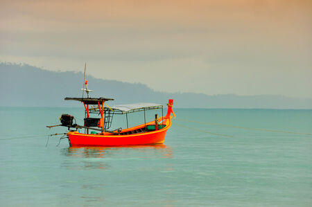 Fishing Boat at beach and sunset