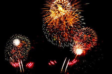 Golden orange amazing fireworks isolated photo