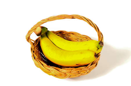 bananas in basket isolated on white background